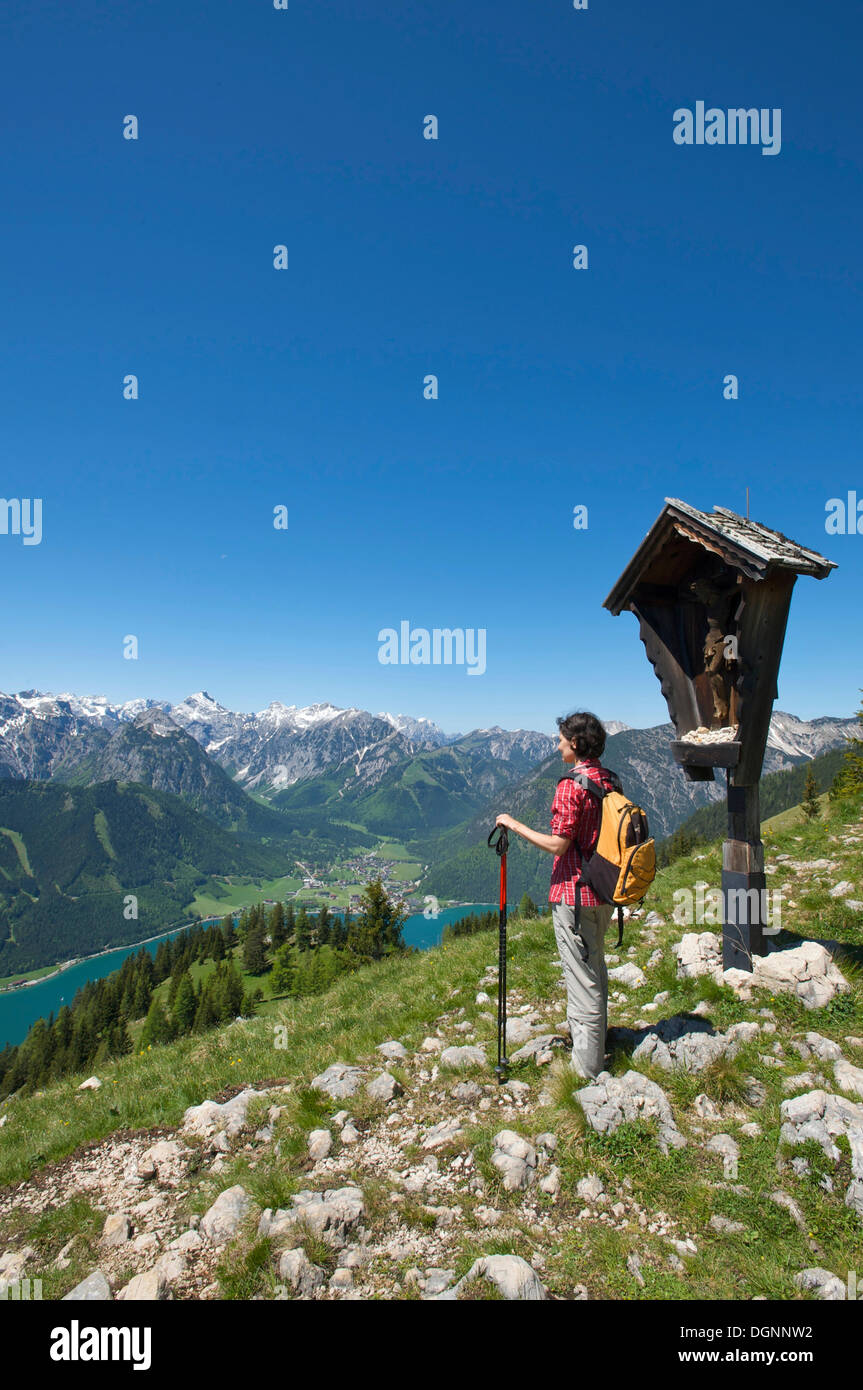 Hiker and Lake Achensee as seen from Durrakreuz viewpoint, Tyrol, Austria, Europe - Stock Image