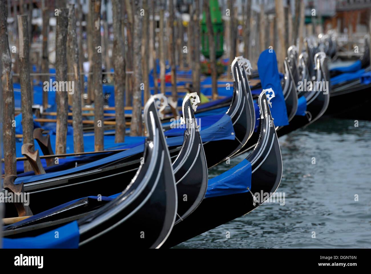 Gondolas on a pier, Bacino di San Marco, Venezia, Venice, Italy, Europe - Stock Image