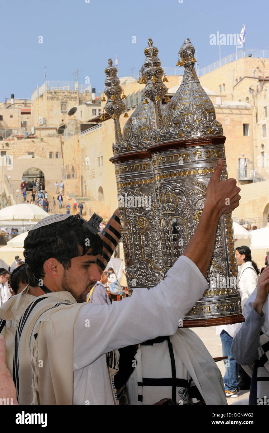 Torah being lifted in all cardinal directions during the Bar Mitzwa ceremony, Jewish quarter of the historic centre in the back - Stock Image