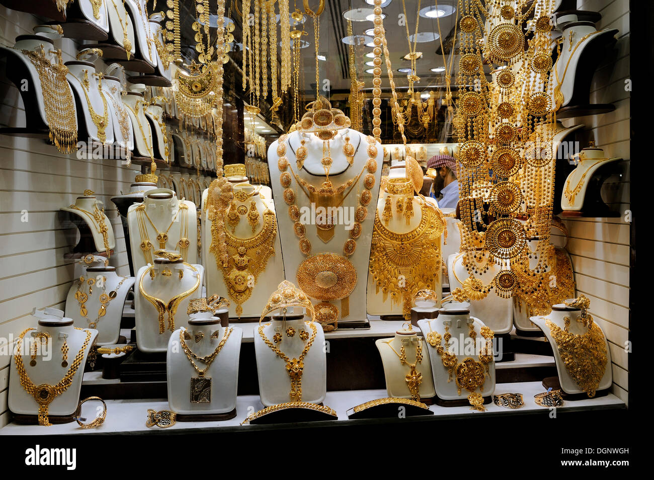 Elaborate jewellery, mainly gold, in a window display in the Deira Gold Souk, Dubai, Emirates, Arabian Peninsula, Middle East - Stock Image