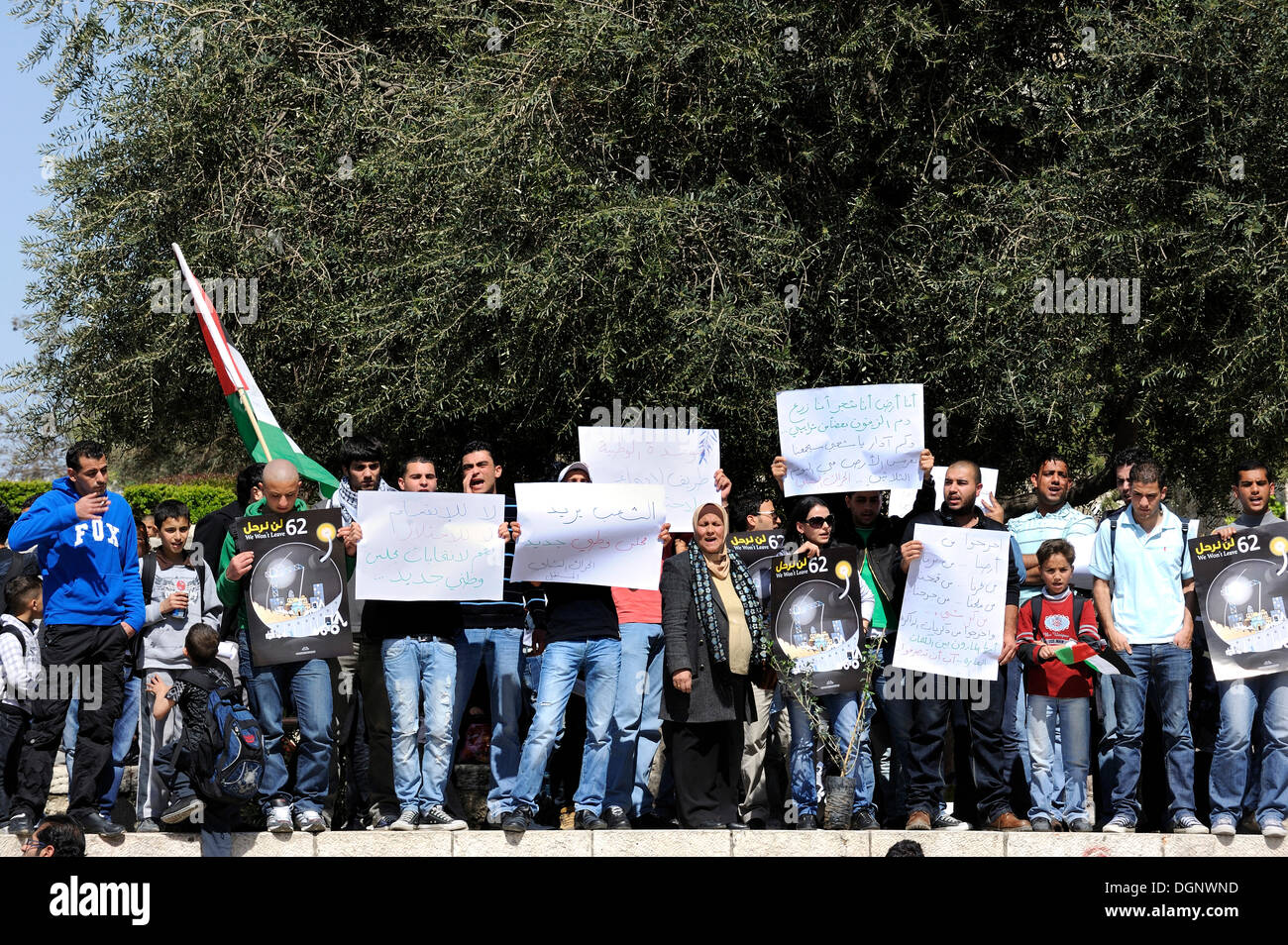 Palestinians demonstrating peacefully with placards and signboards on the steps outside the Damascus Gate against - Stock Image