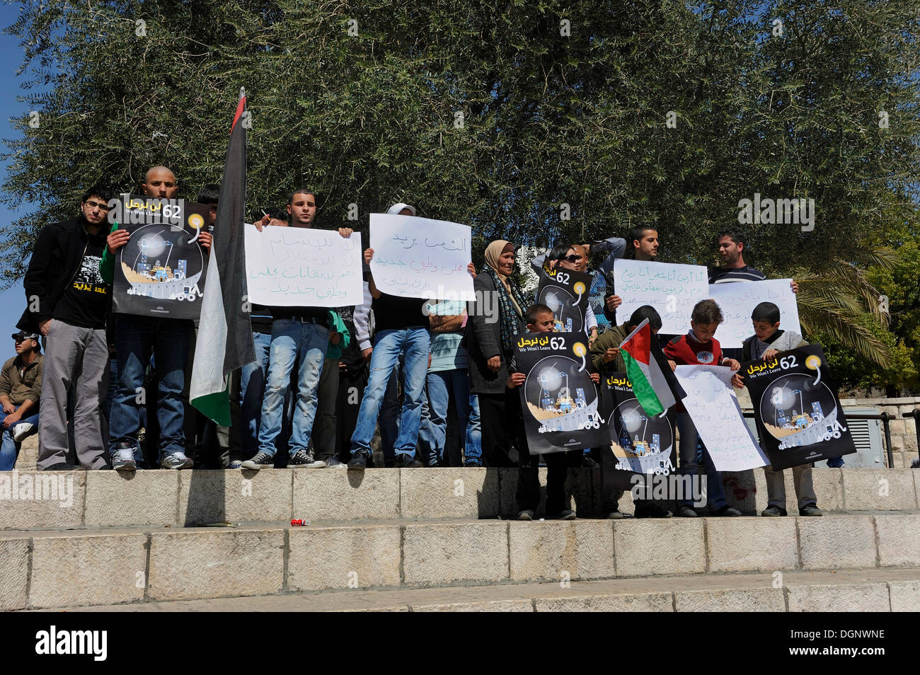 Palestinians demonstrating peacefully with placards and posters against the Israeli settlement policy at the Damascus - Stock Image