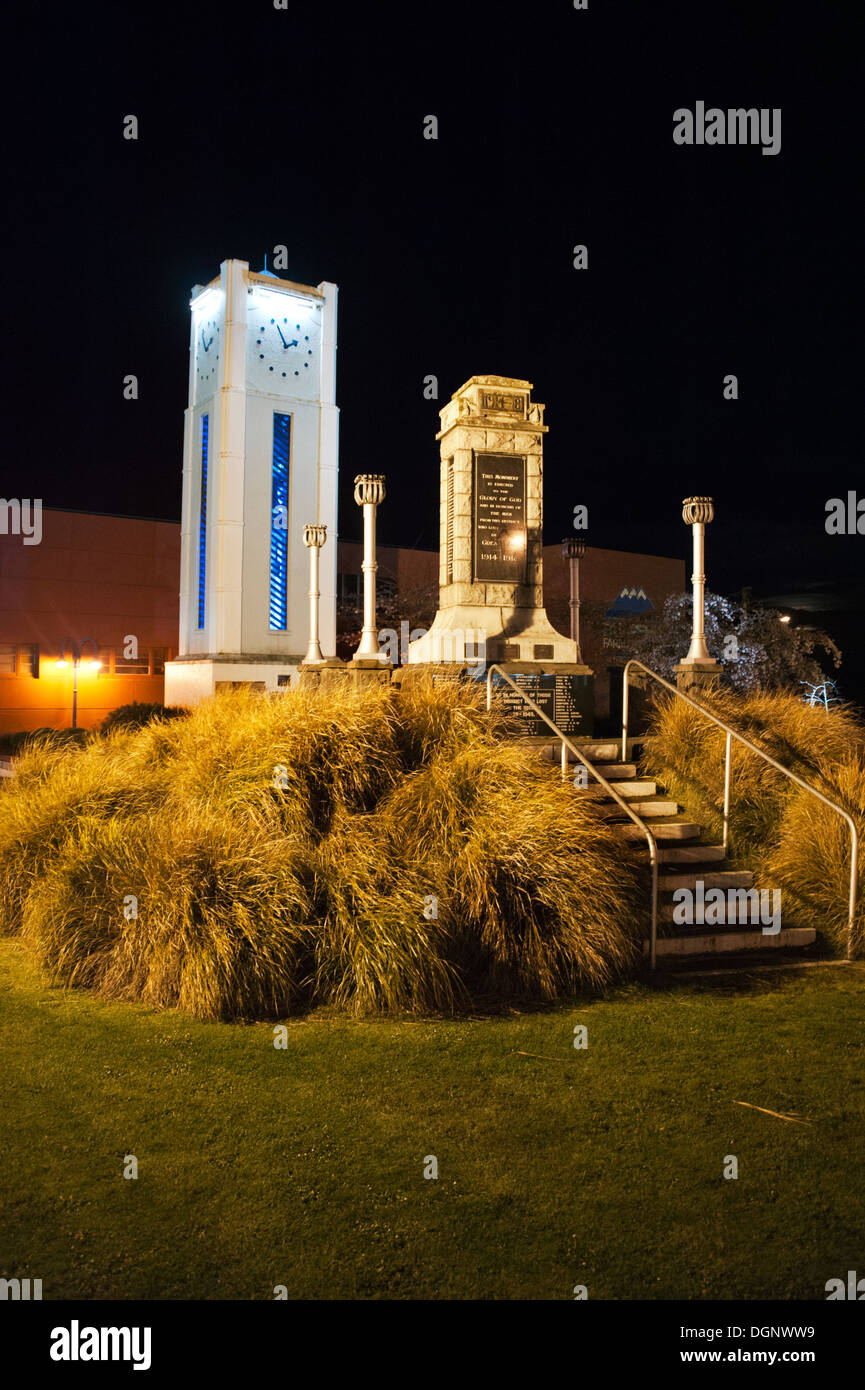 The small town of Taihape, North Island, New Zealand. Art deco clock tower and war memorial illuminated at night. - Stock Image