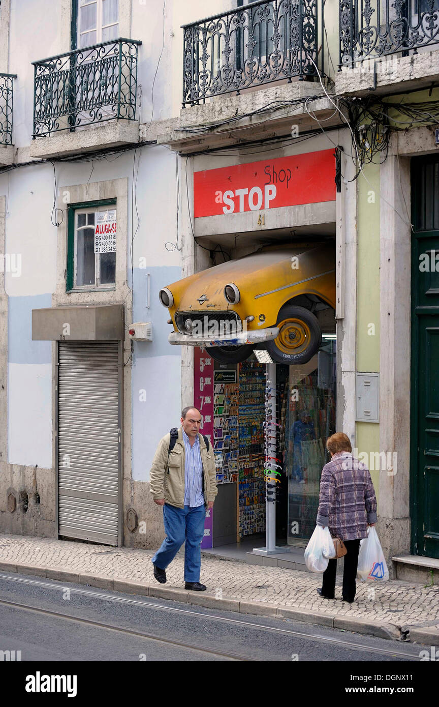 Souvenir shop selling curiosities in the historic district, has a radiator of a car hanging above the entrance, Chiado district - Stock Image