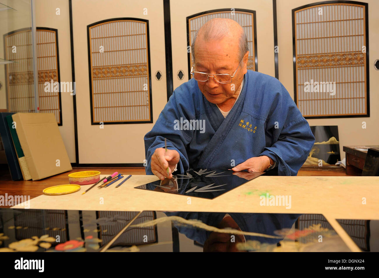 Japanese artisan in his workshop, scraping a bamboo motif into the top lacquer coat, Sabae, Fukui, Japan, East Asia, Asia - Stock Image