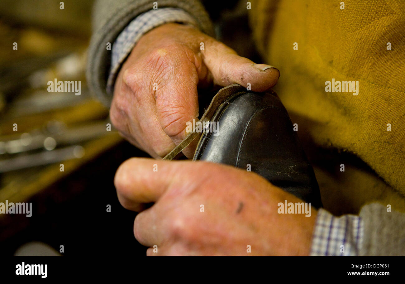 Shoemaker working - Stock Image