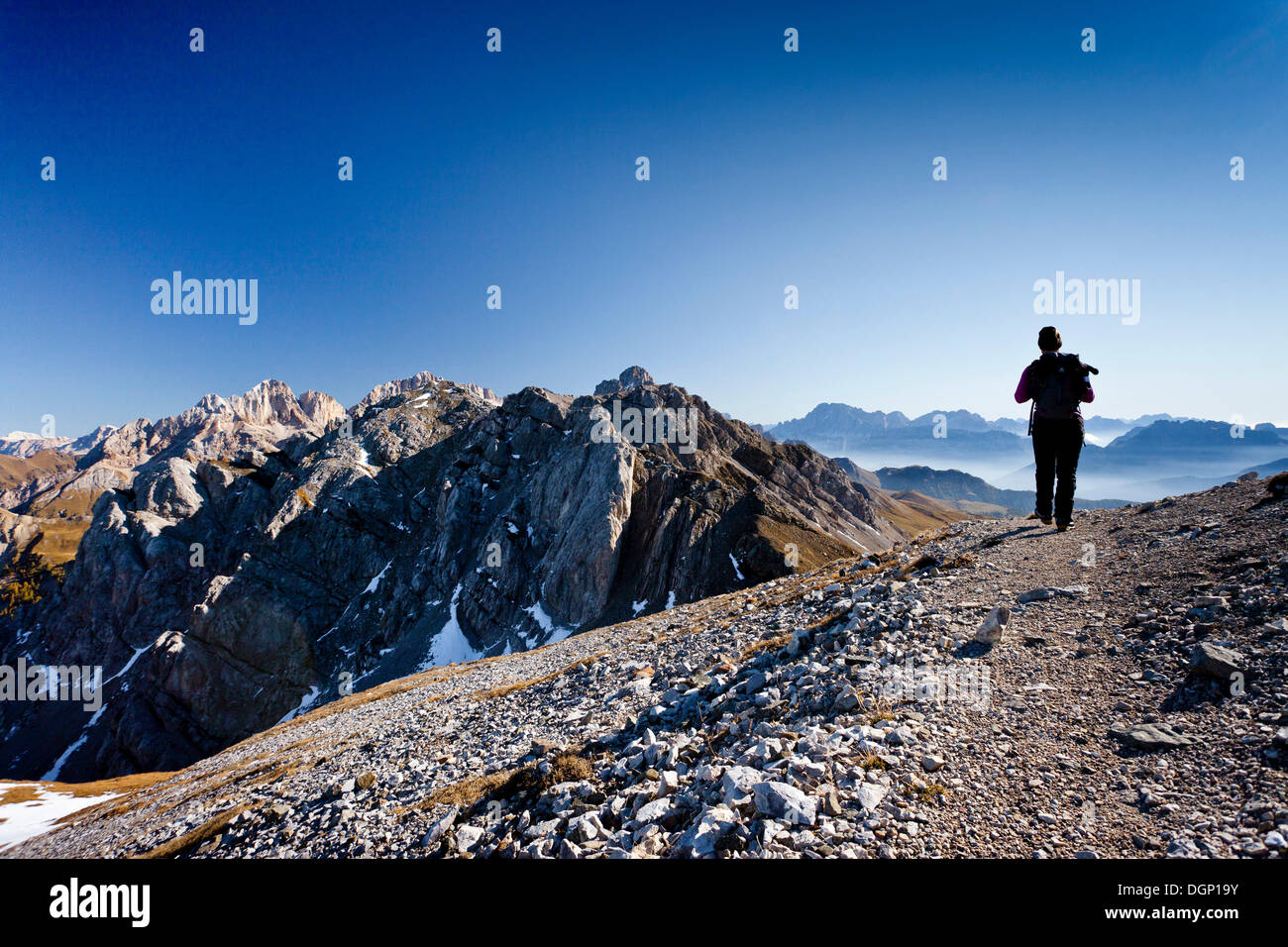 Hiker during the ascent to the Bepi-Zac fixed rope route in the San Pellegrino Valley above the San Pellegrino Pass, Stock Photo