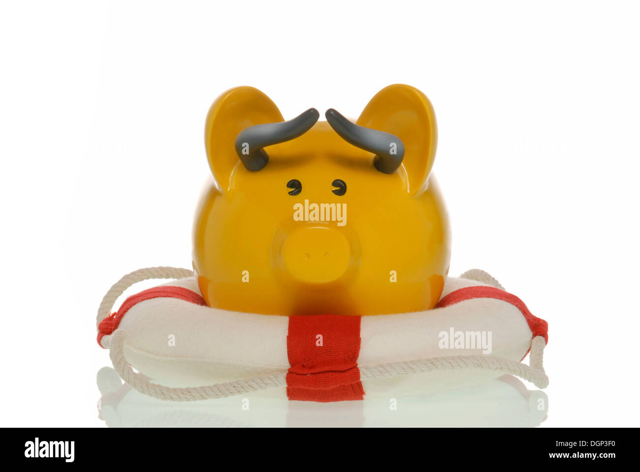 Piggy bank with horns like a stock market bull in a life ring, symbolic image for saving the stock market - Stock Image