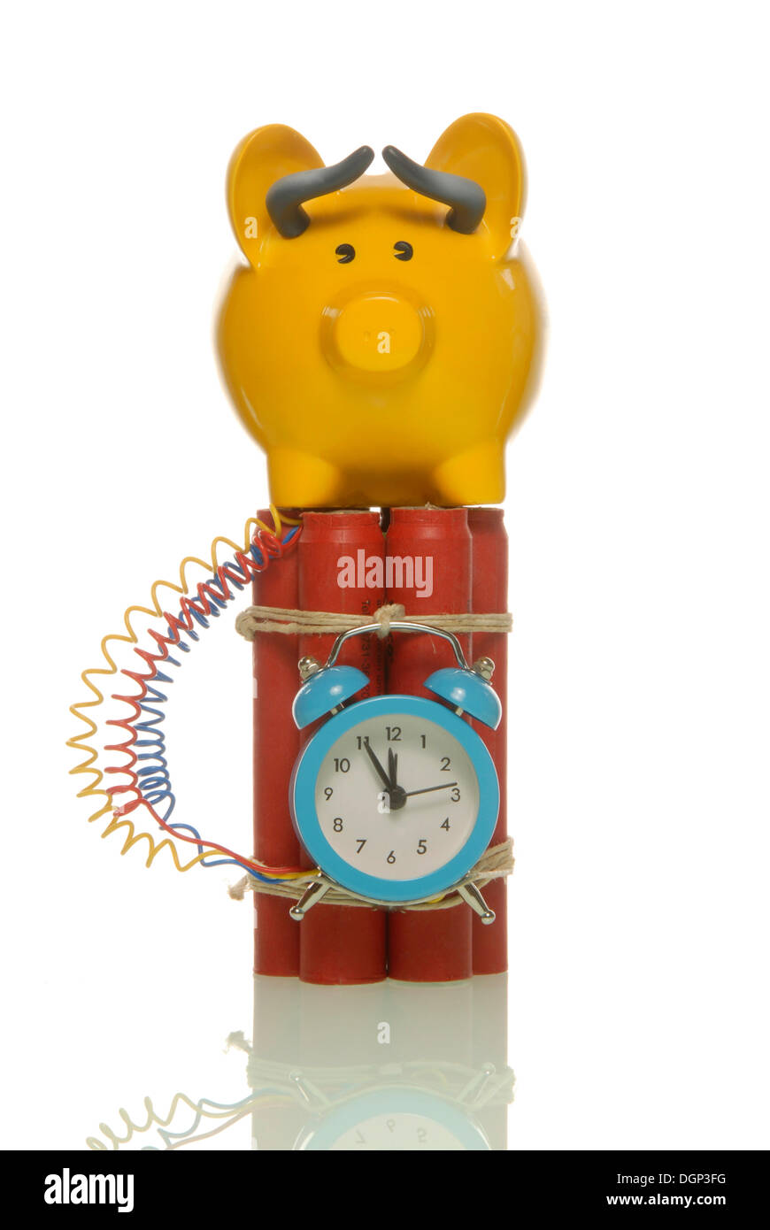 Piggy bank dressed as a stock market bull on a bomb, symbolic image for a dangerous stock exchange - Stock Image