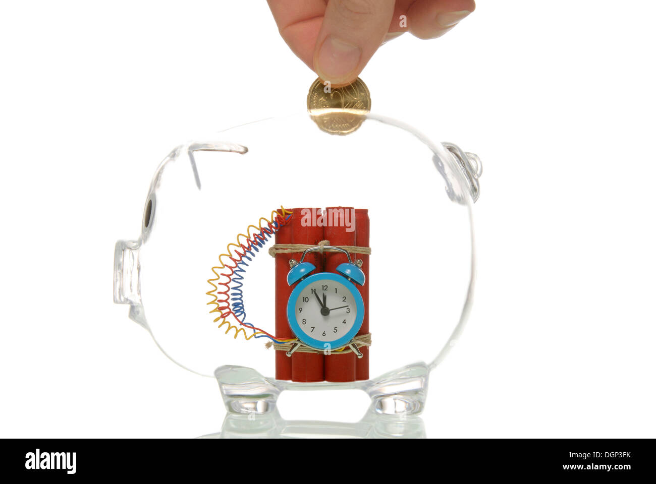 Transparent piggy bank with a bomb, symbolic for bank crisis - Stock Image