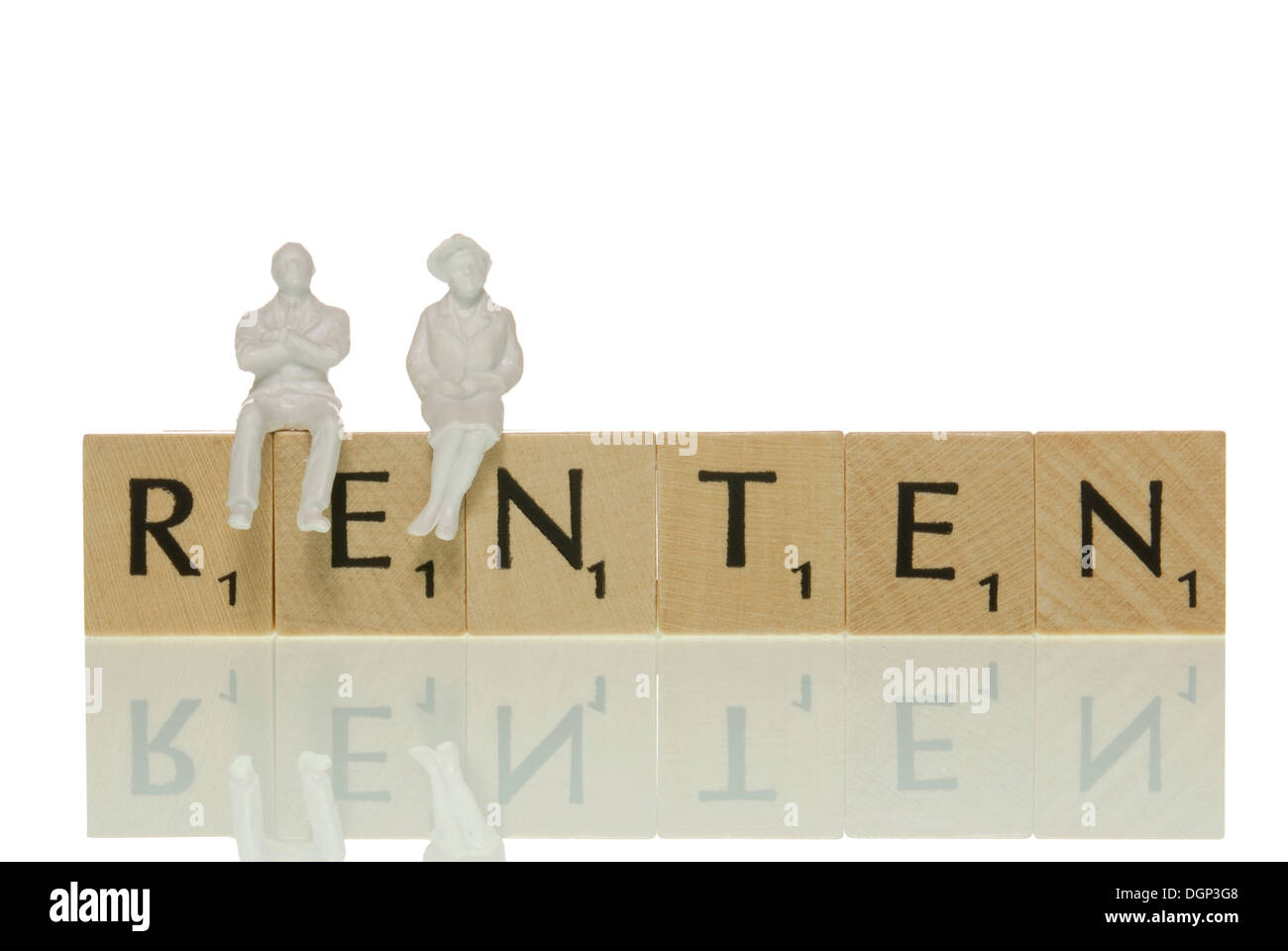 Two figures sitting, waiting on letter tiles forming the word 'Renten', German for 'old-age pension' - Stock Image