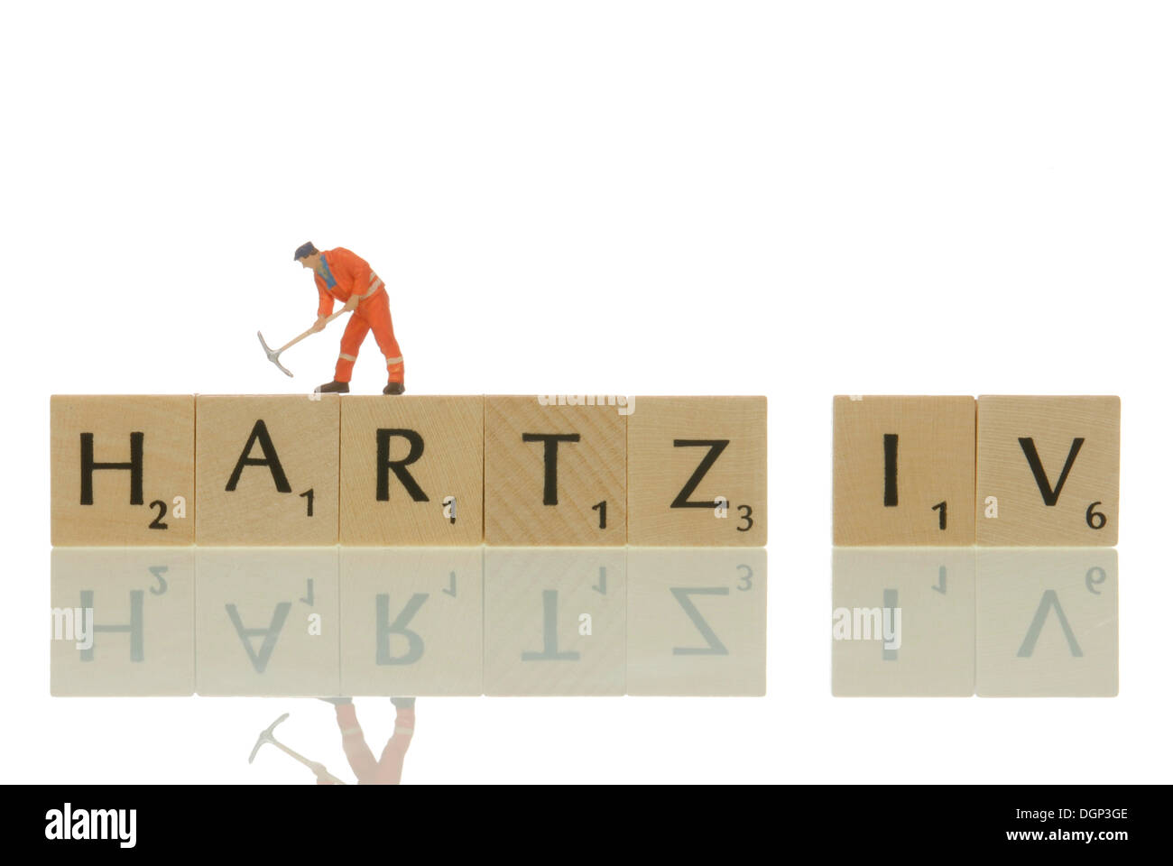 Figurine of contruction worker on the lettering 'Hartz IV', symbolic for Hartz IV building site - Stock Image