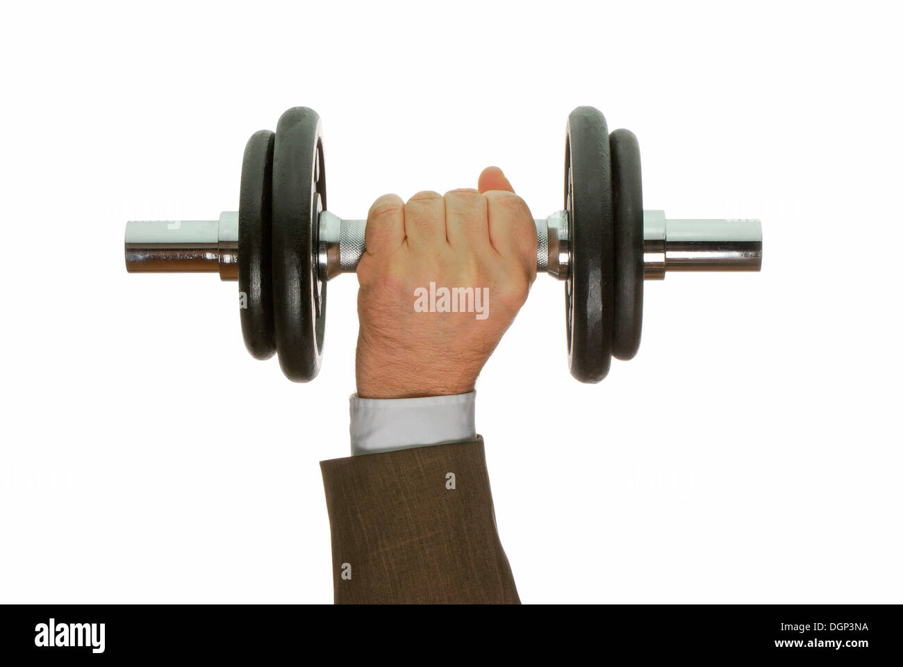 Business man's hand lifting a dumbbell - Stock Image