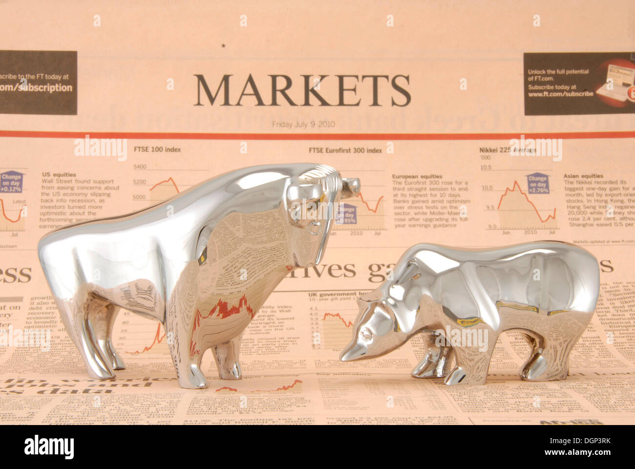 Bull and a bear standing on a financial newspaper, symbolic image for stock market Stock Photo