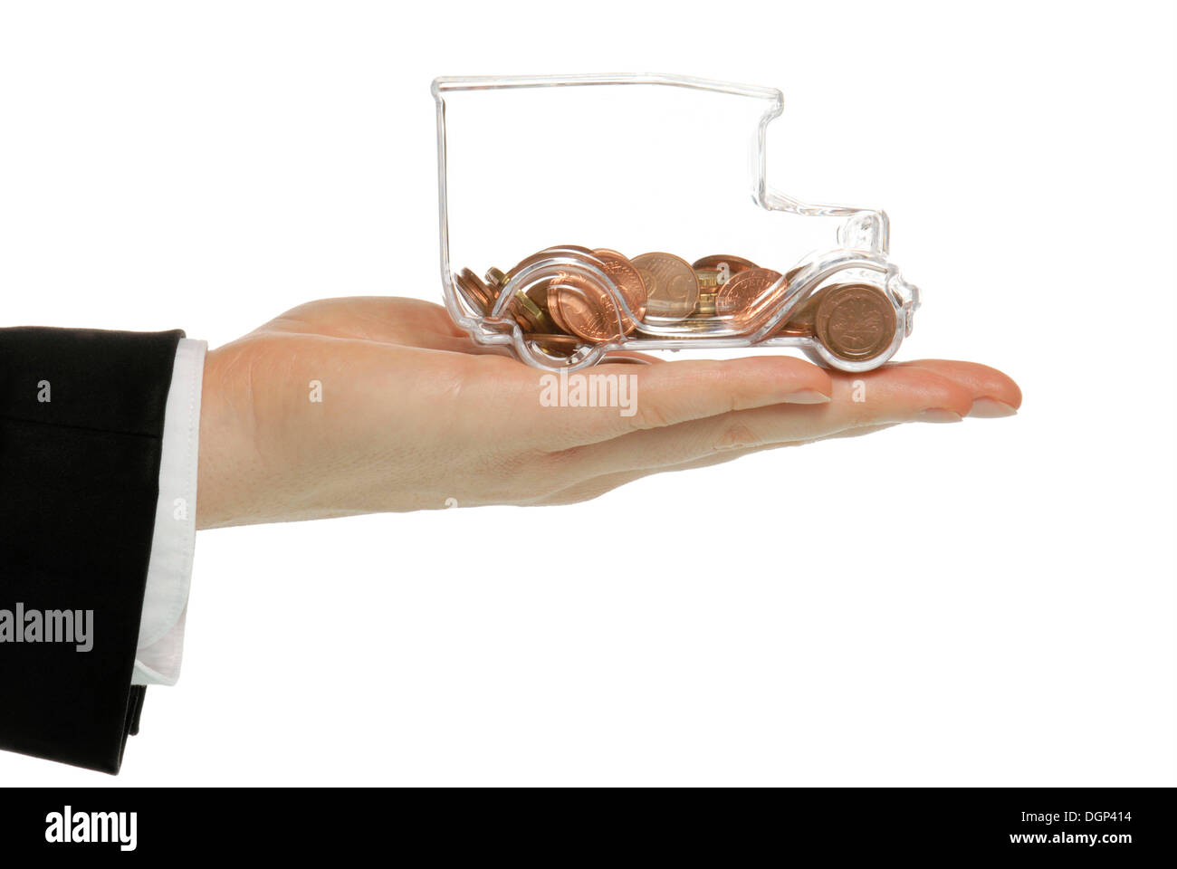 Business man holding a transparent model truck full of euro coints, symbolic image for transparency in transport costs - Stock Image