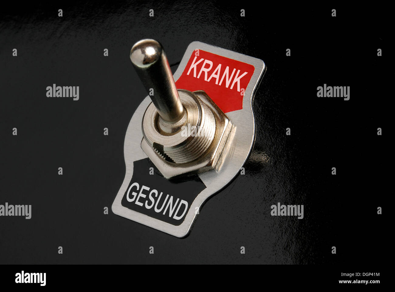 Toggle switch, labelled Krank and Gesund, German for sick and healthy, symbolic image - Stock Image