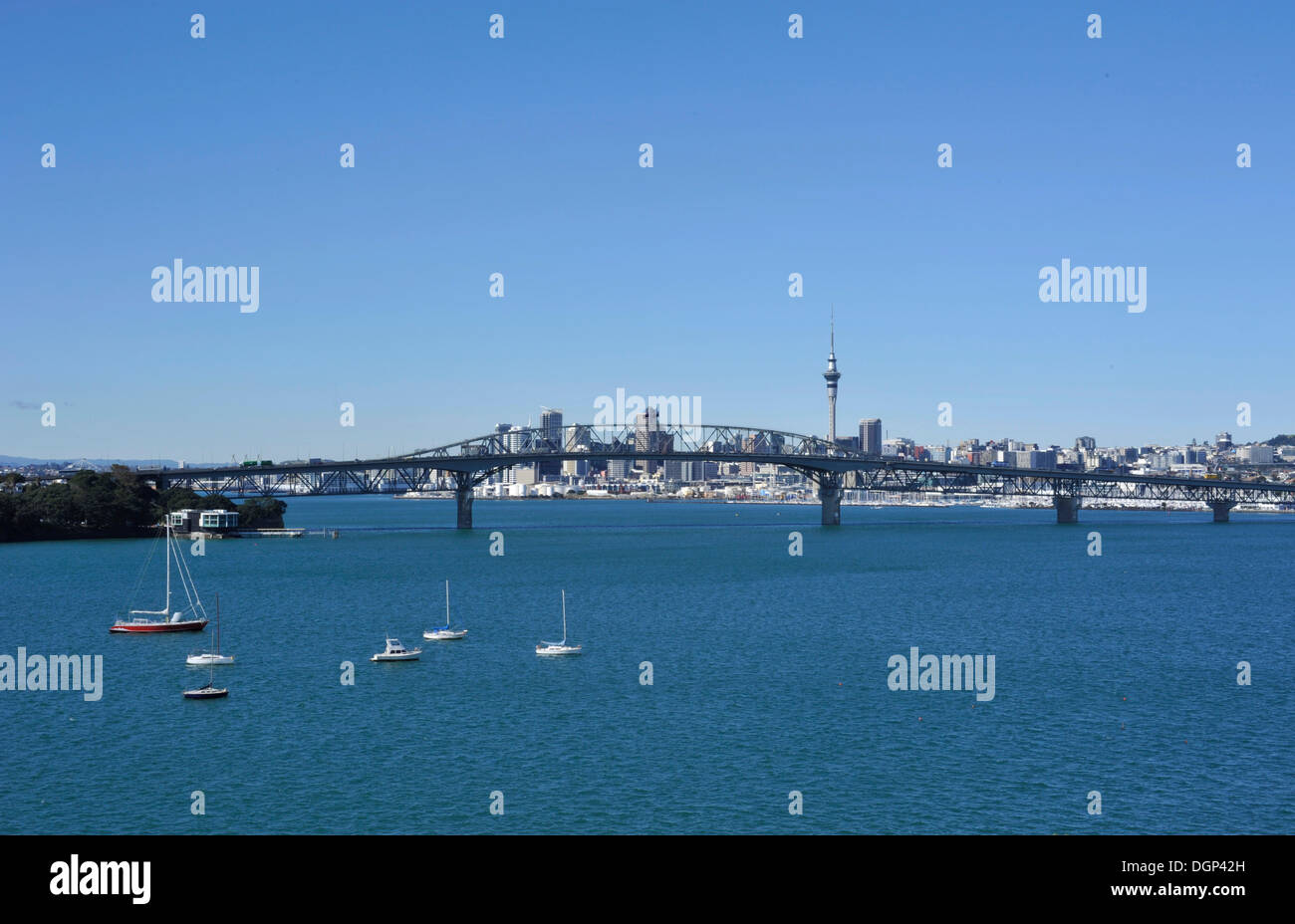 View from Birkenhead on Harbour Bridge and skyline with Skytower, Auckland, New Zealand - Stock Image