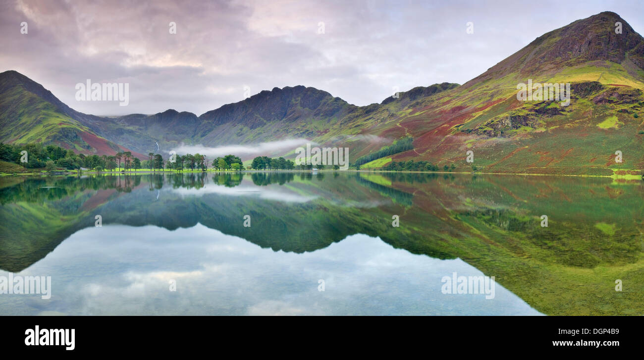 Mountains reflected on Buttermere Lake, refected in the water, Lake District, Cumbria, England, United Kingdom, Europe - Stock Image