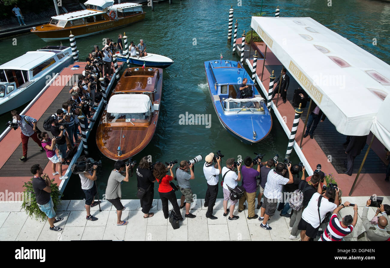 Curious Paparazzi photographers filming celebrities at Venice Film Festival's landing stage, Venice, Italy. - Stock Image