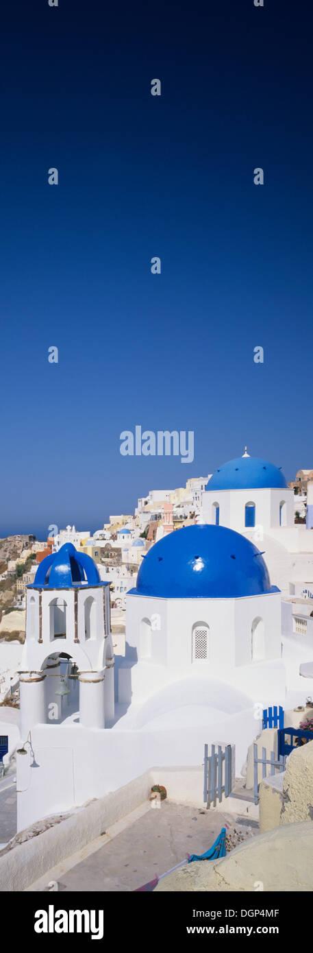 Blue cupolas of a church, Oia, Santorini, Cyclades, Greece, Europe - Stock Image