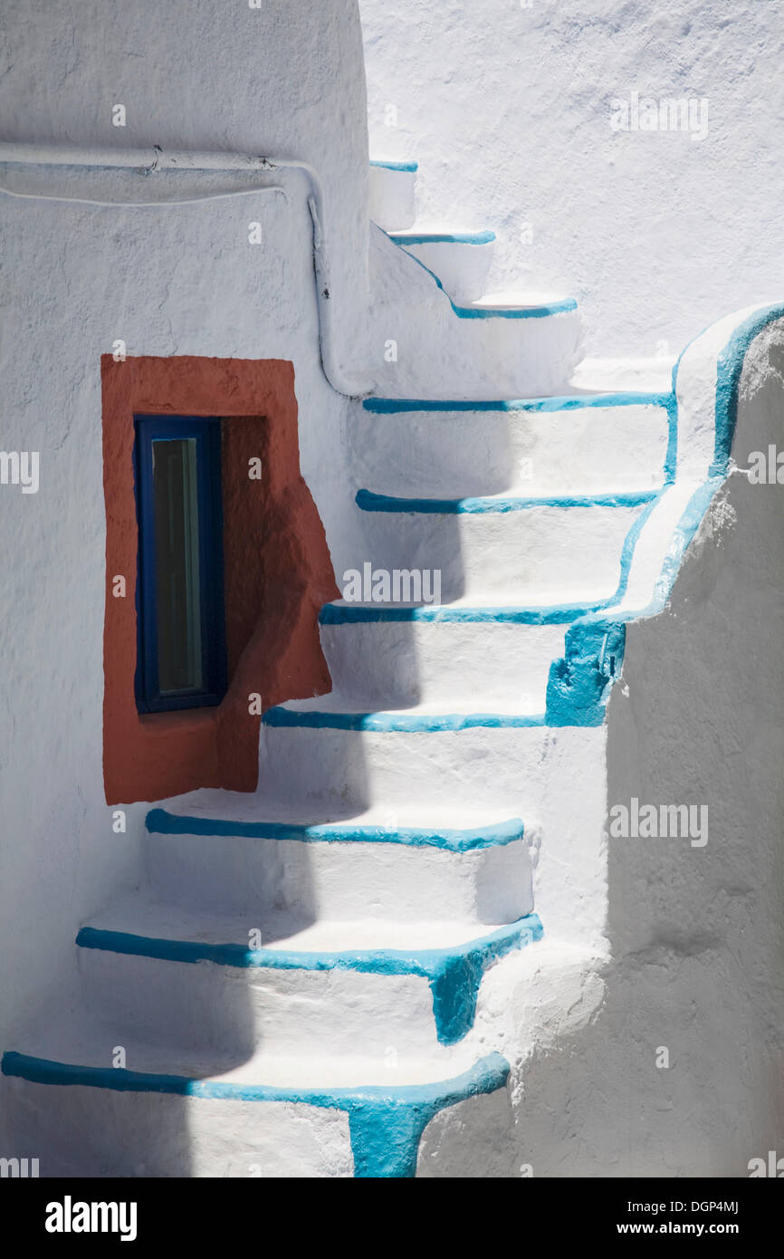 Painted stairs besides window, Fira, Santorini, Cyclades, Greece, Europe - Stock Image