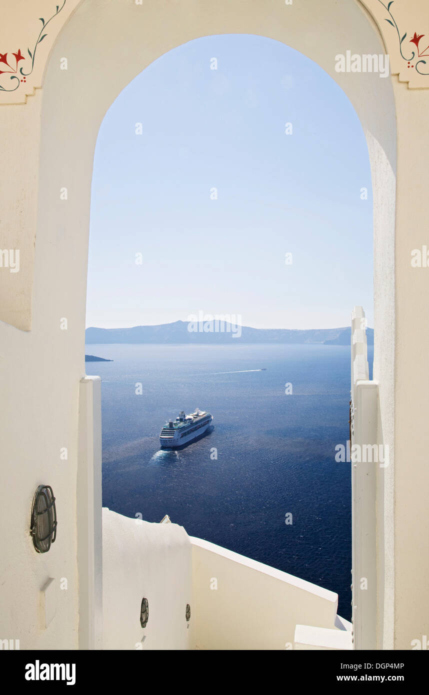 Cruise liner in the Aegean Sea off Fira, Santorini, Cyclades, Greece, Europe - Stock Image