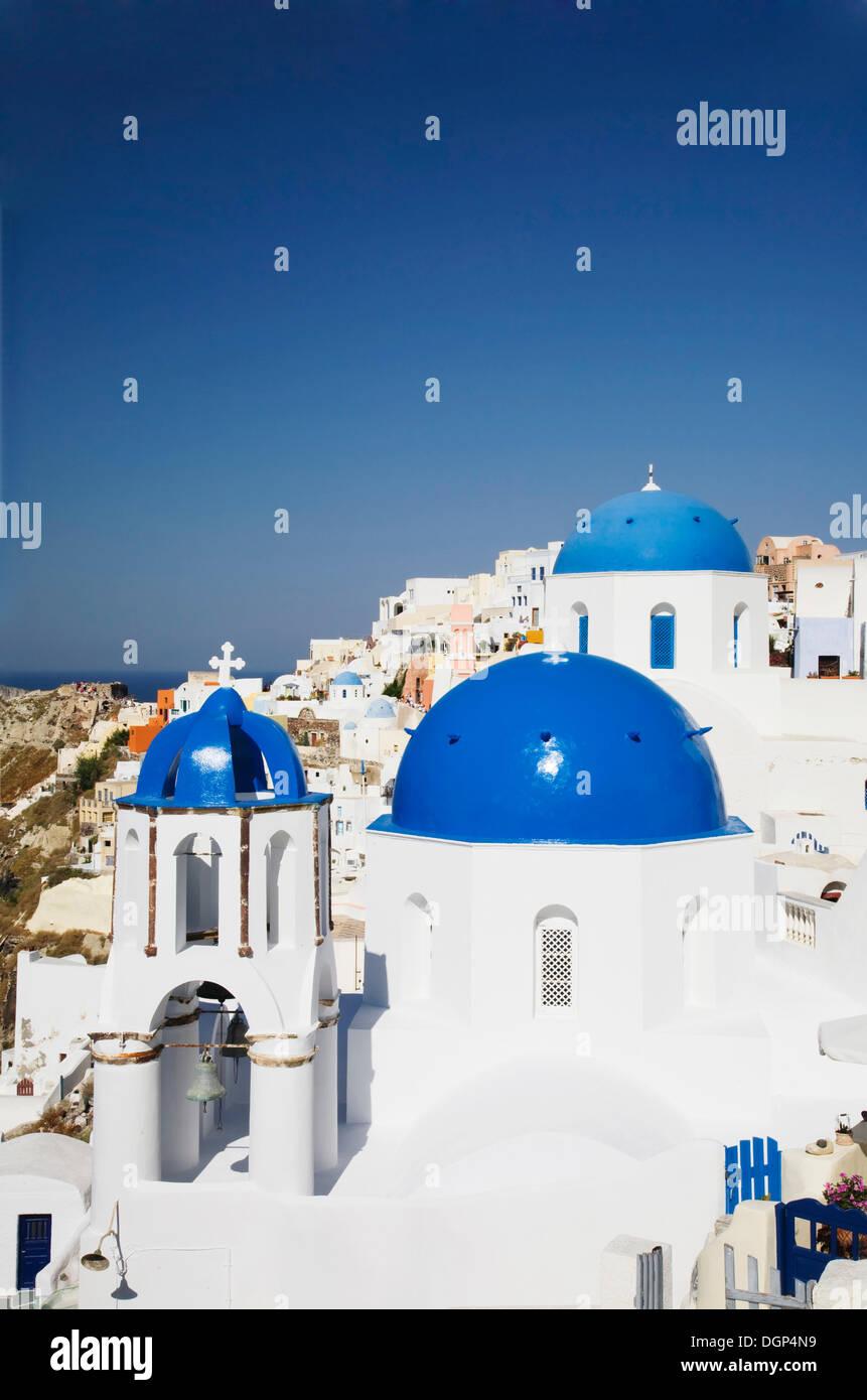 Blue church cupolas, Oia, Santorini, Cyclades, Greece, Europe - Stock Image