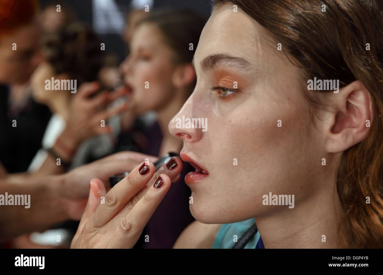 Berlin, Germany, makeup is applied in the models at Fashion Week - Stock Image