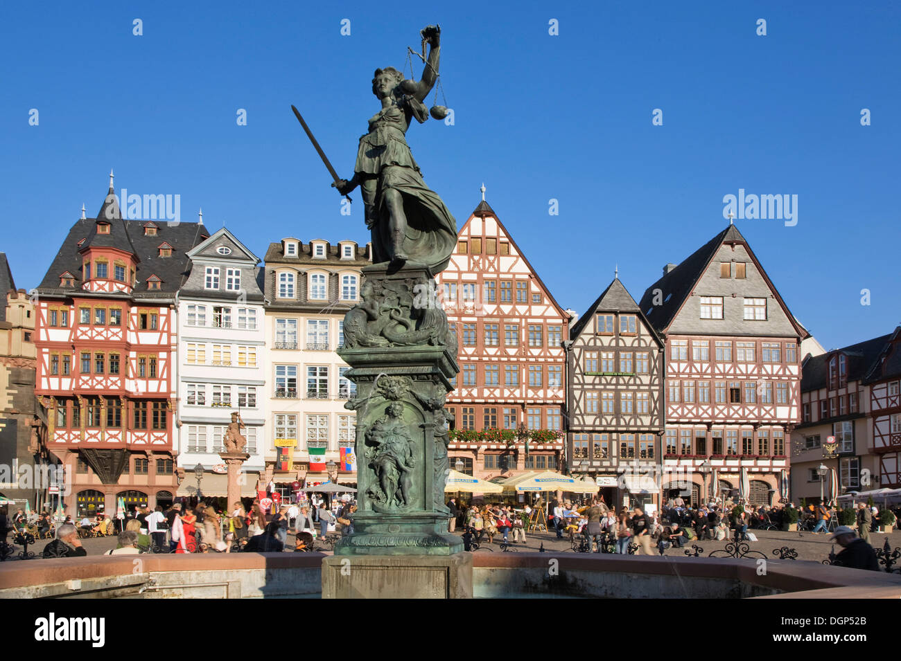 Half-timbered building ensemble on Roemerberg Square with the Justitia Fountain, Frankfurt, Hesse - Stock Image