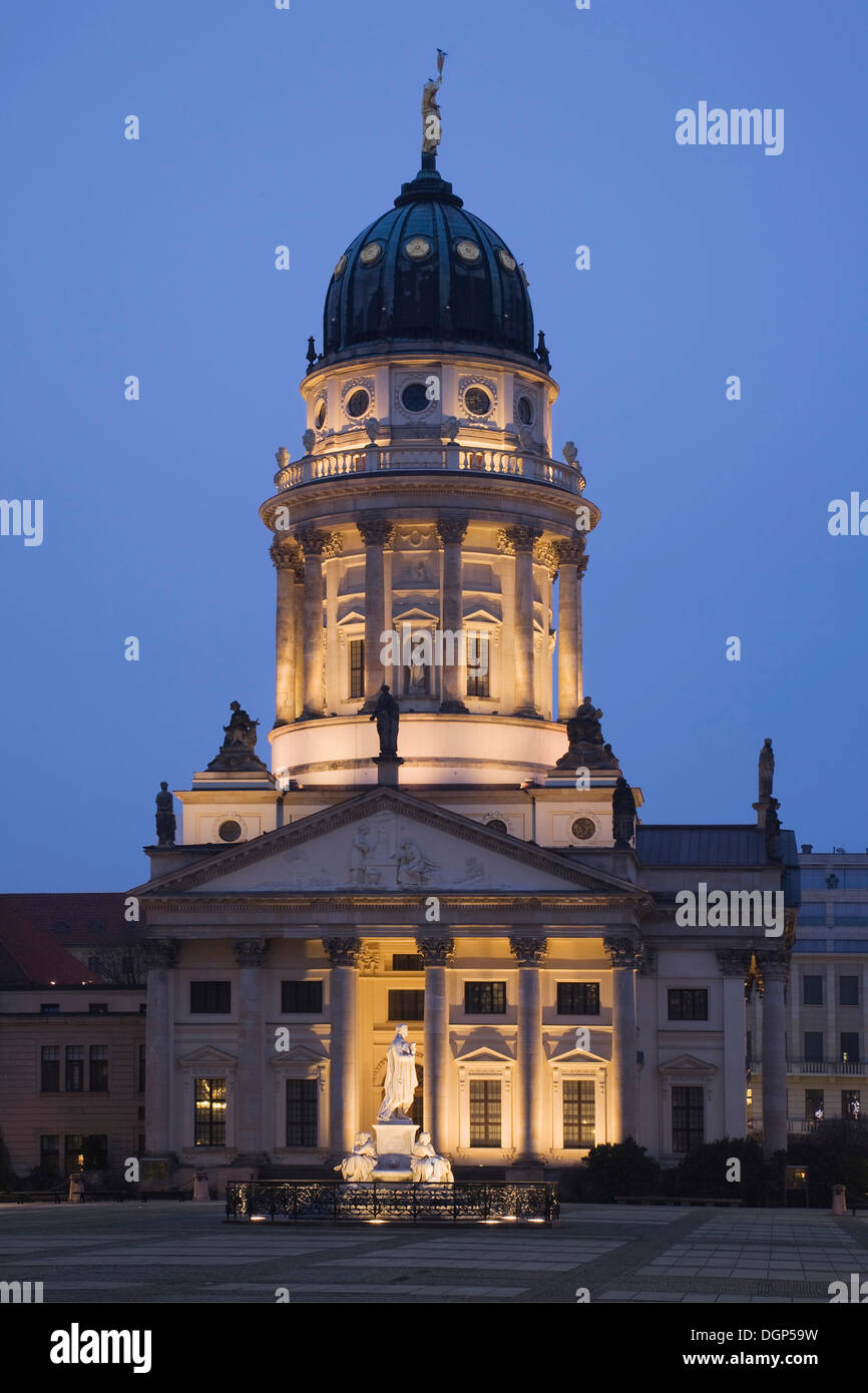 French Cathedral with a Schiller monument at the Gendarmenmarkt square, Mitte, Berlin Stock Photo