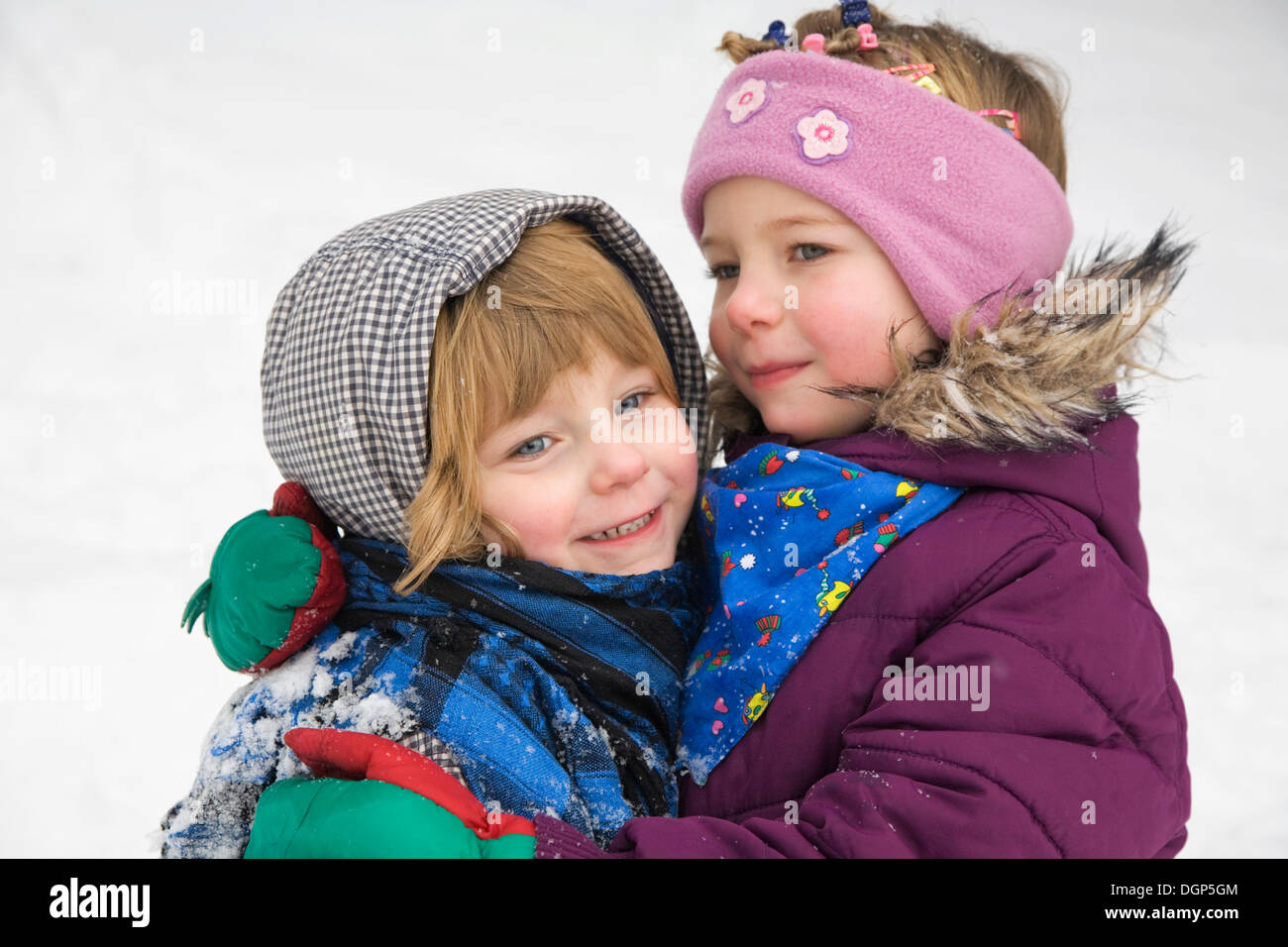 Two sisters hugging each other - Stock Image