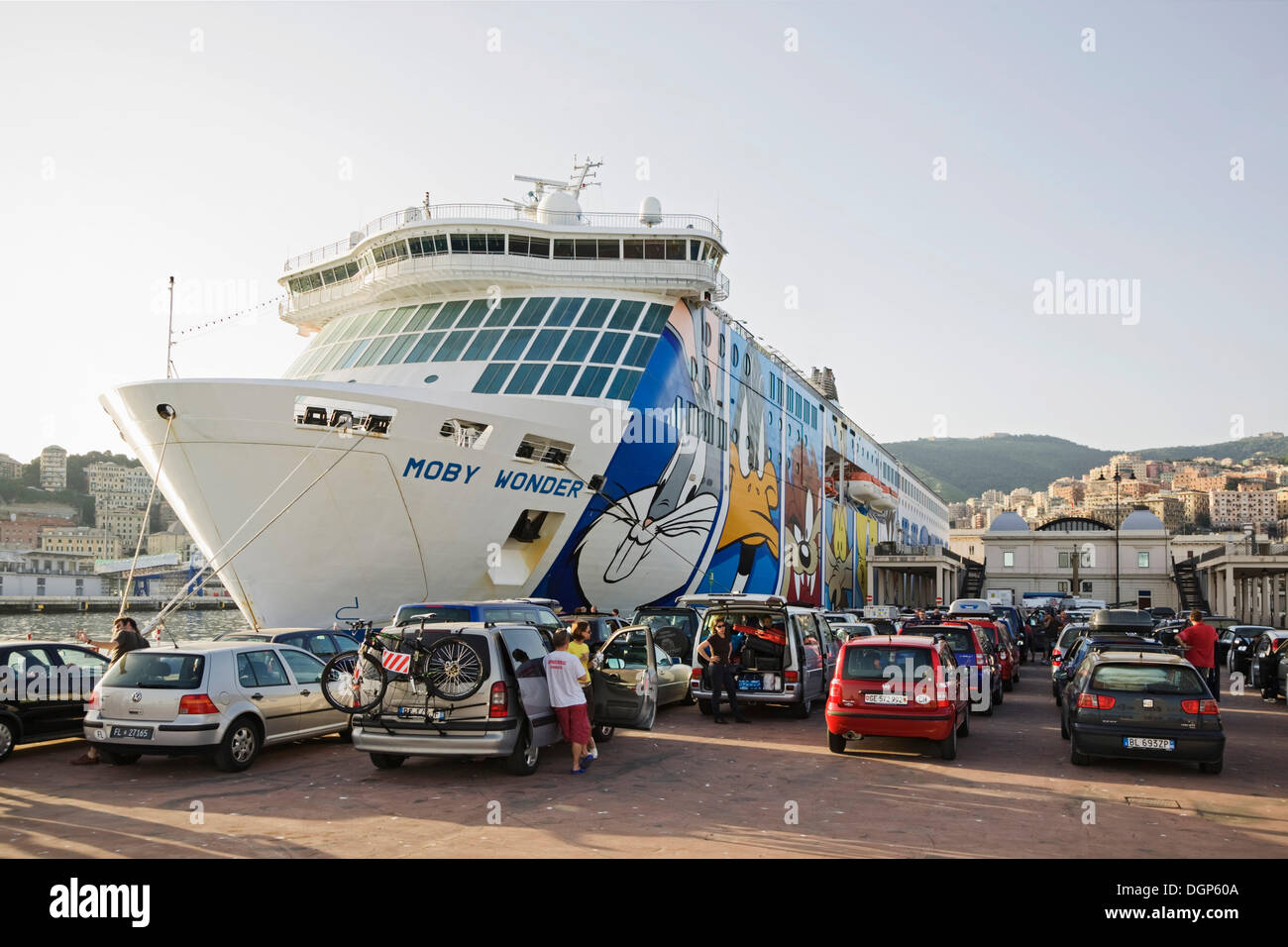 Ferry port of Genoa with travellers waiting for the ferry to Sardinia, Liguria, Italy, Europe - Stock Image
