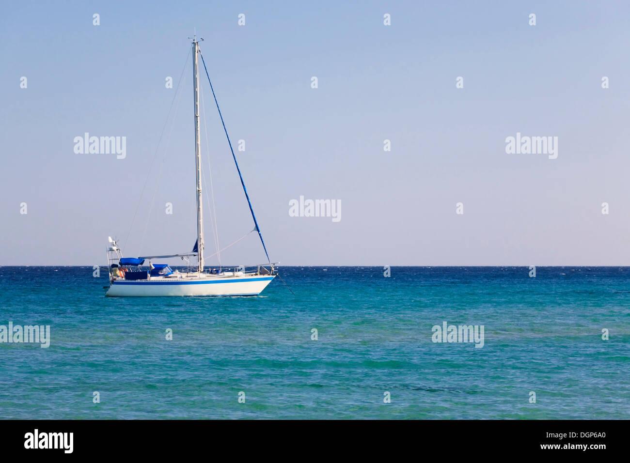 Sailboat on the Costa del Sud, Sulcis Province, Sardinia, Italy, Europe - Stock Image
