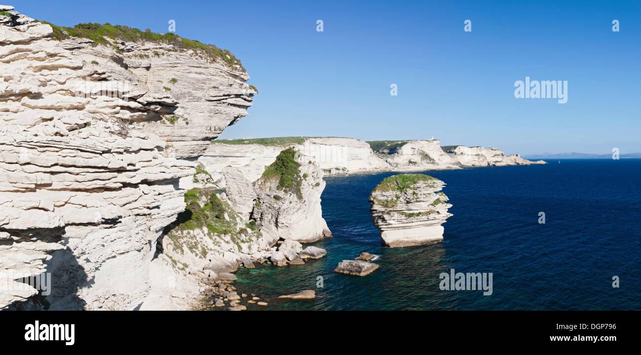 Chalk cliffs and the free-standing rock Grain de Sable, Strait of Bonifacio, Corsica, France, Europe - Stock Image