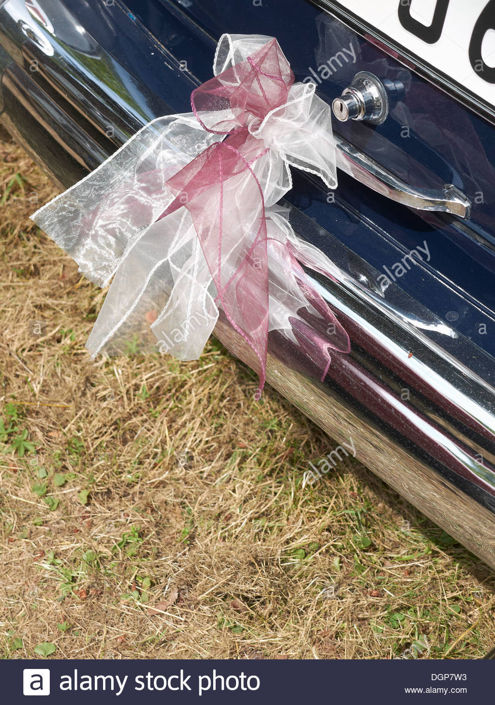 Germany, Hesse, Vintage car decorated with ribbon - Stock Image