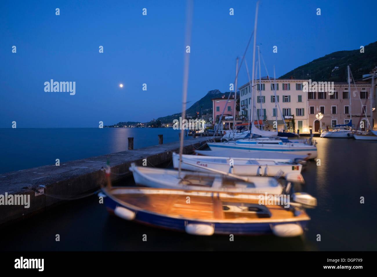 Moon over the port of Gargnano, Lake Garda, Lombardy, Italy, Europe - Stock Image