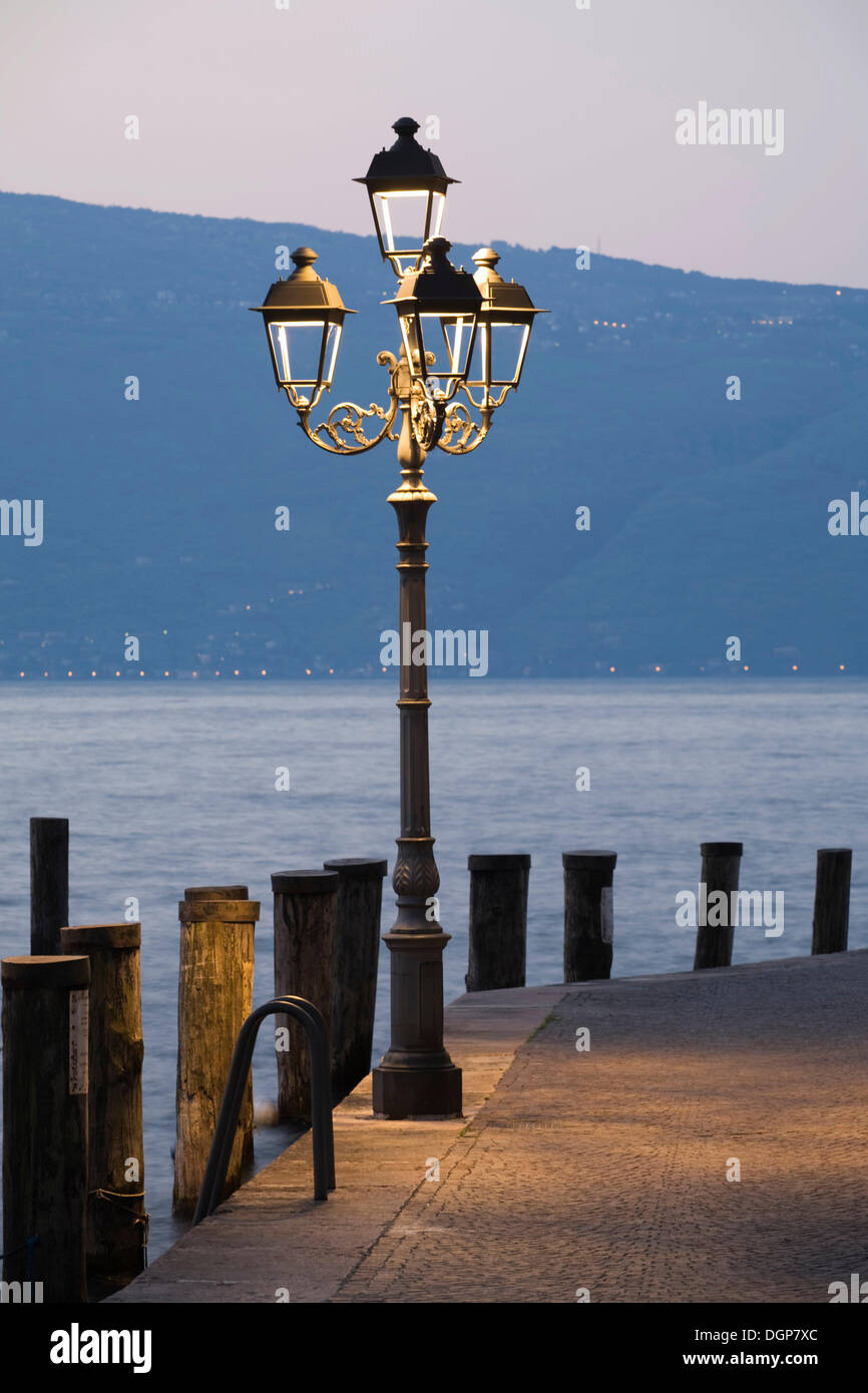Streetlight at the port of Gargnano, Lake Garda, Lombardy, Italy, Europe - Stock Image