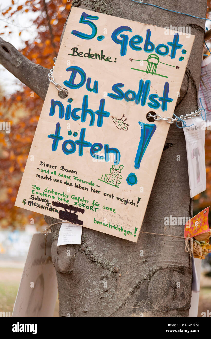 Protest poster, '5. Gebot, Du sollst nicht toeten', German for '5th Commandment, Thou shalt not kill' on an old tree against the - Stock Image