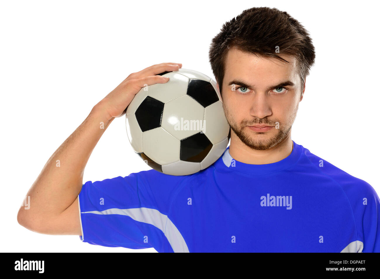 Portrait of young soccer player holding ball isolated over white background - Stock Image