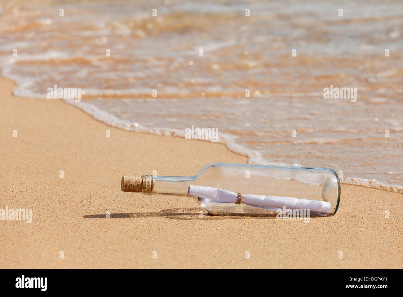 Message in a bottle lying on the beach, Risco del Paso, Fuerteventura, Canary Islands, Spain - Stock Image