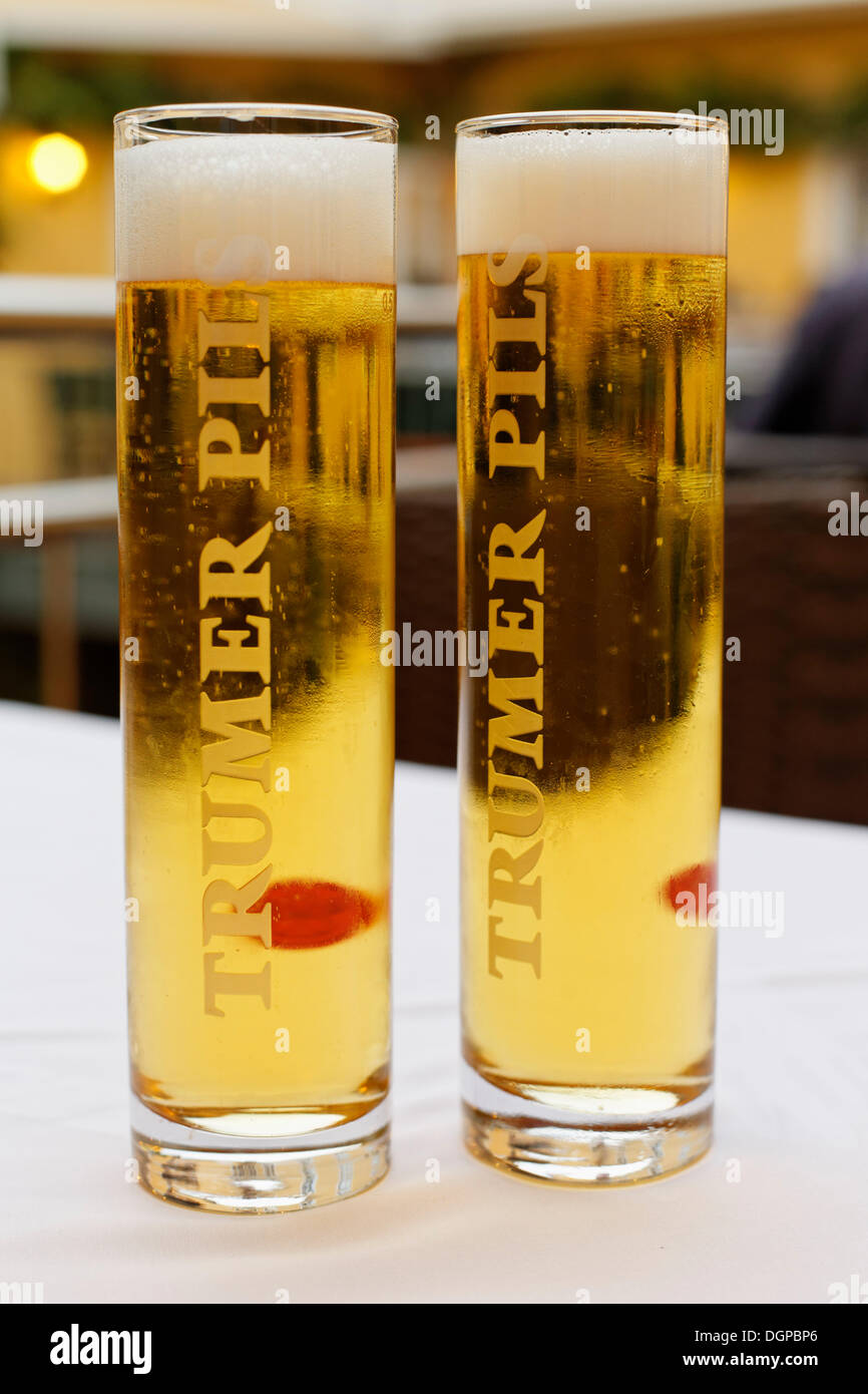 Two glasses of beer labelled Trumer Pils, from Salzburg, Grein, Upper Austria, Austria, Europe - Stock Image