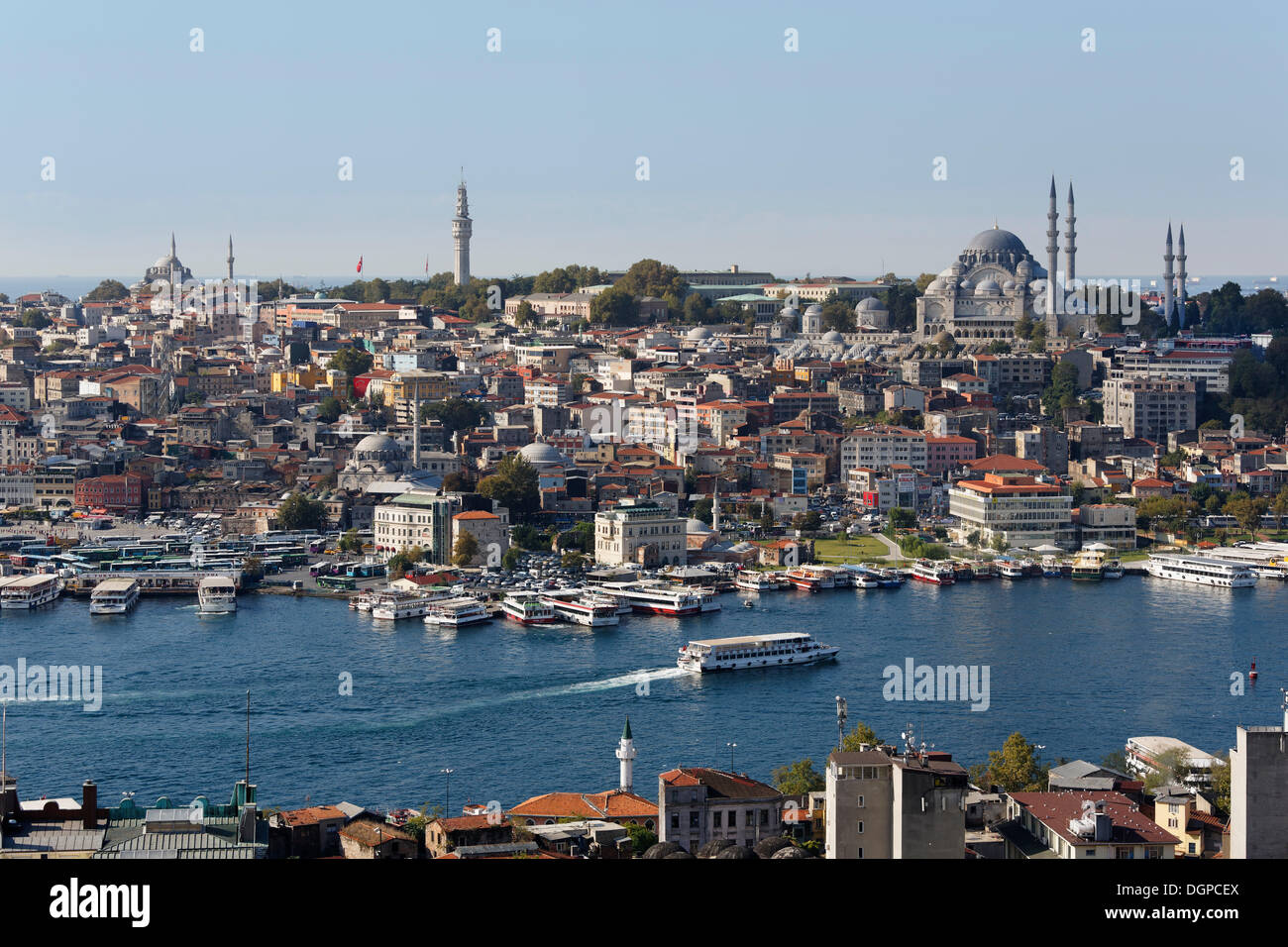 Golden Horn with the Eminönü neighbourhood, Beyazit Tower, left, Süleymaniye Mosque, right, view from Galata Tower, Istanbul - Stock Image