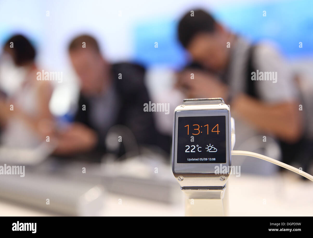 Berlin, Germany, visitors try out the new Samsung Galaxy Gear at IFA 2013 - Stock Image