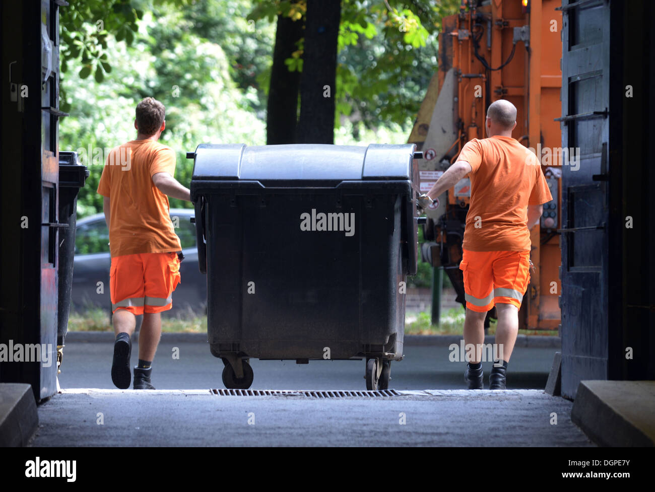 Berlin, Germany, employees of the BSR empty trash cans - Stock Image