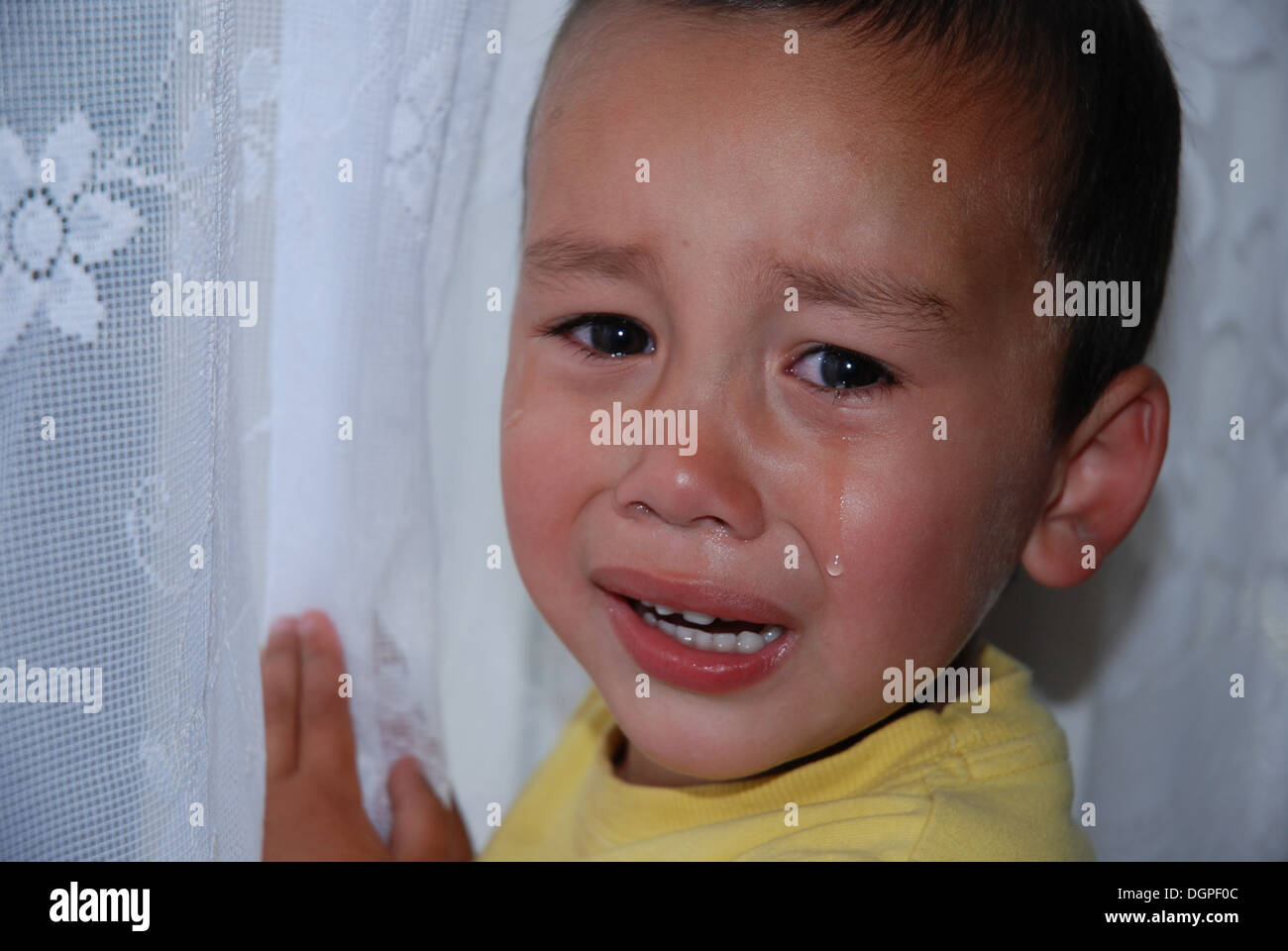 A young child crying, upset and unhappy - Stock Image