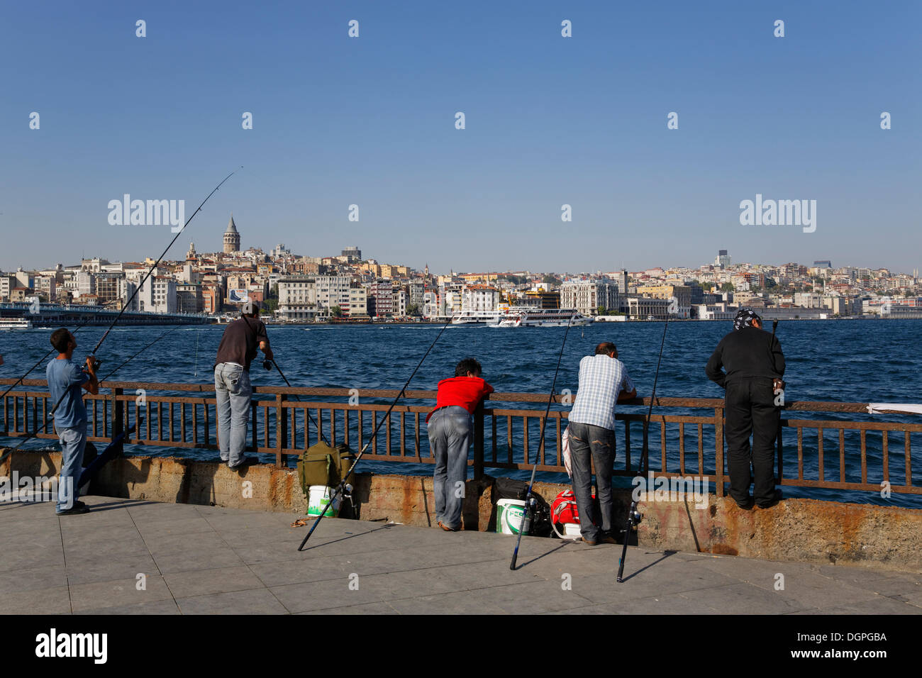 Anglers in Eminönü, Golden Horn, with Beyoglu at the rear, Istanbul, european side, Turkey, Europe, PublicGround - Stock Image