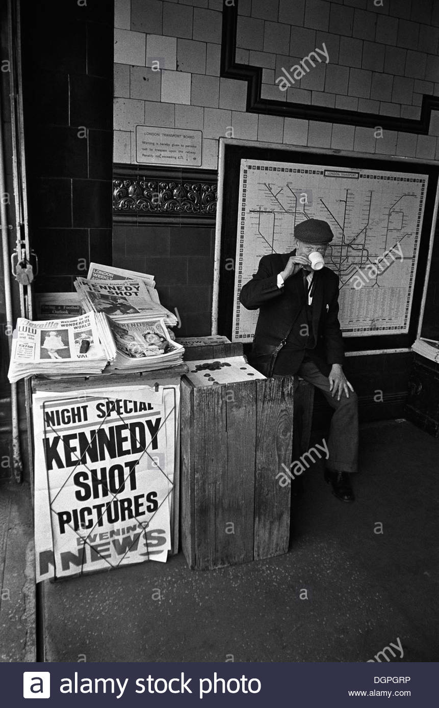 Newspaper seller in tube station entrance with placards announcing the assasination of Robert Kennedy, London - Stock Image