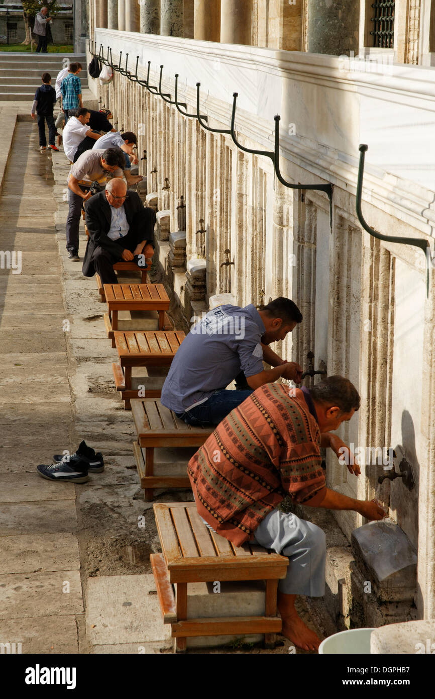 Devout Muslims making ablution at the fountain in front of Suleymaniye Mosque, Istanbul, Turkey, Europe, Istanbul - Stock Image