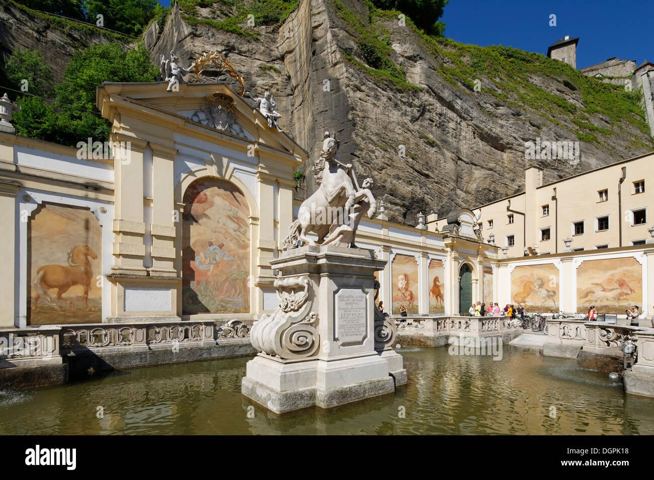 Stables with a horse tamer statue by Bernhard Michael Mandl, Pferdeschwemme Baroque fountain, historic center, Salzburg - Stock Image