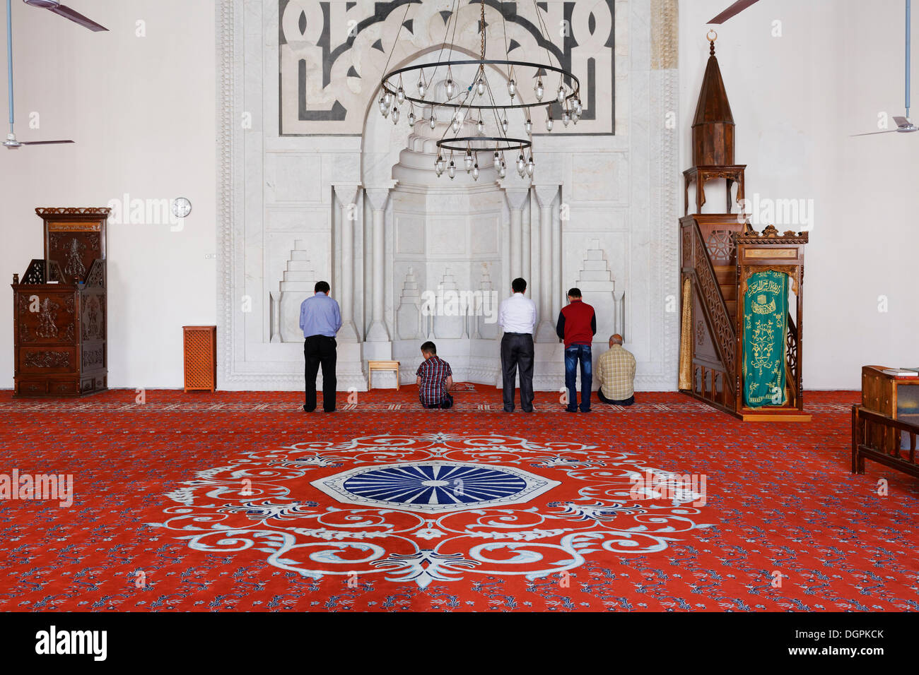 Muslims praying in the prayer room of the İsabey Mosque, Selçuk, İzmir Province, Aegean Region, Turkey - Stock Image
